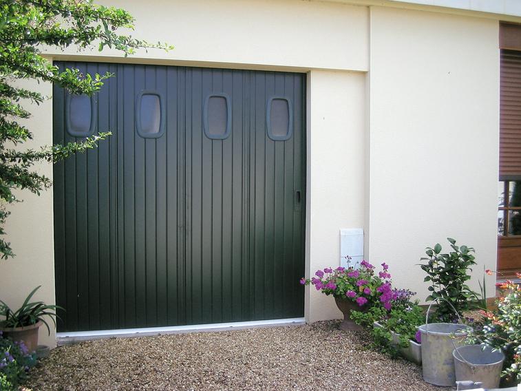 Porte de garage coulissante conception et installation for Garage des fontaines
